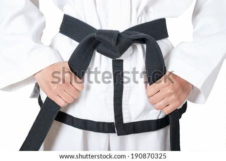 Closeup Black Belt Taekwondo athletes. Hand fist  - stock photo