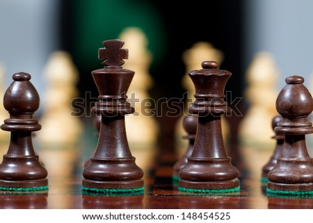Closeup black king and queen Set of chess figures on the playing board - stock photo