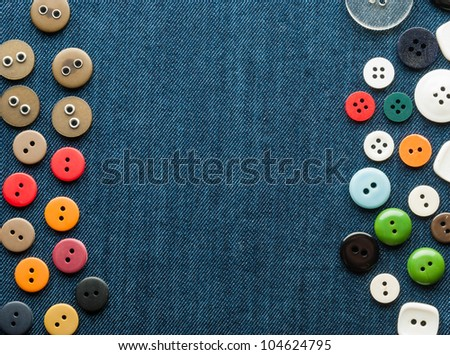 Closeup blue jeans background with different buttons. Space for your text. - stock photo