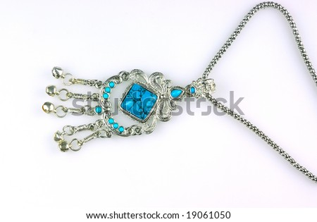 Closeup blue necklace on white background