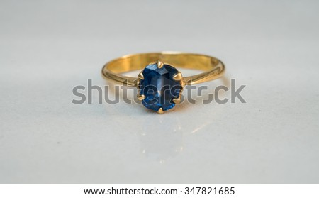 Closeup blue pebble ring on blurred marble floor background in black and white tone - stock photo