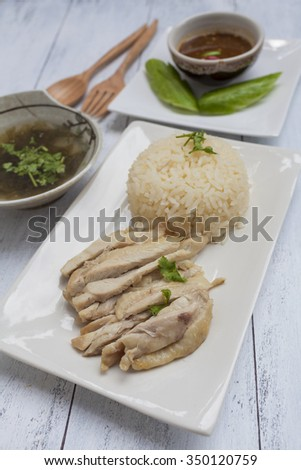 Closeup Boil Chicken With Rice And Clear Soup With Spicy Thai Style Sauce