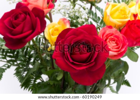 Closeup bouquet of red, pink, yellow roses isolated on white background. - stock photo