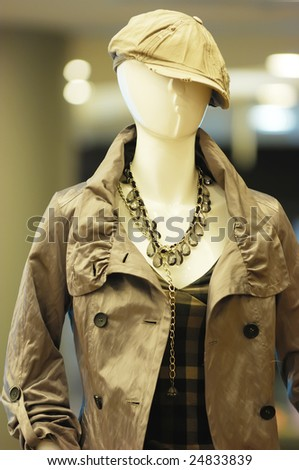 closeup boutique display window with mannequins - stock photo