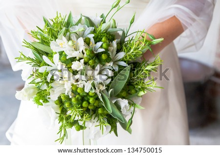 closeup bride holding bouquet white roses - stock photo