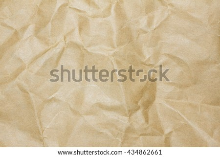 Closeup brown recycled crumpled paper texture. Brown recycled crumpled paper background with copy space for text or image. - stock photo