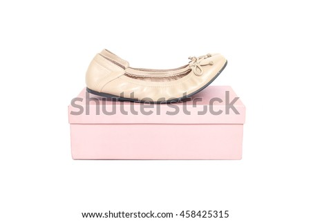 Closeup brown woman shoes on pink paper box of shoes isolated on white background - stock photo
