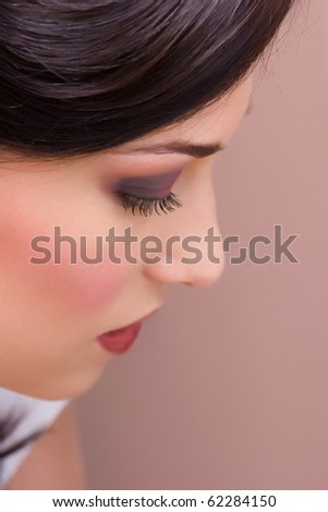 closeup brunette young lady get ready for the event by makeup artist - stock photo
