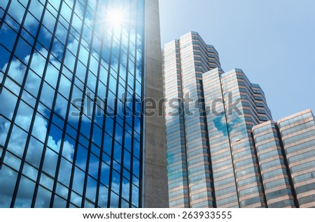 Closeup building glass of skyscrapers with cloud, Business concept of architecture - stock photo