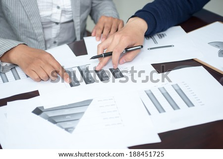 Closeup business people fingers, analysis diagram is discussed in this paper