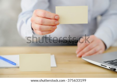 Closeup. Business woman offers business card to the client
