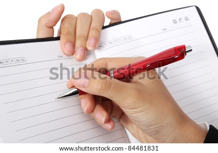 Closeup business woman write on her book on white background