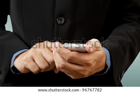 closeup Businessman touch smart phone in hand - stock photo