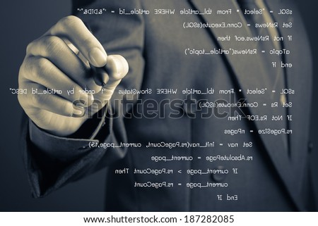 Closeup businessman writing computer source code on screen - stock photo