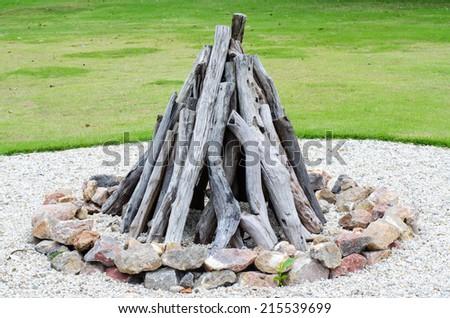 closeup campfire preparation in field - stock photo