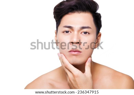 closeup charming young man face  - stock photo