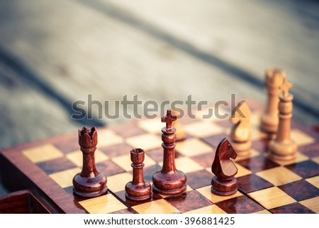 Closeup chess pieces of one team on chessboard, teamwork or partnership concept - stock photo