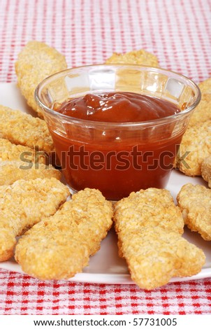 closeup chicken fingers focus on bowl - stock photo