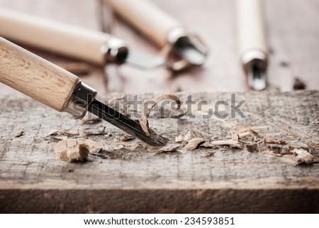 closeup chisels for wood on carpenter desktop - stock photo