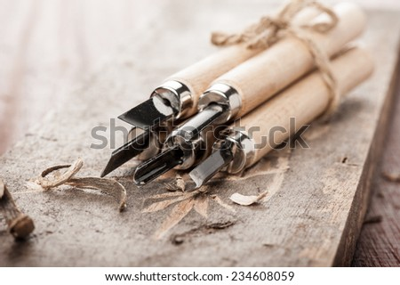 closeup chisels for wood on carpenter desktop - stock photo