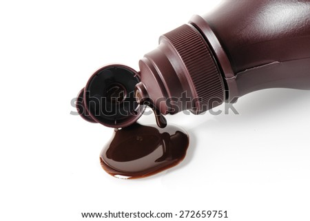 closeup chocolate syrup pouring on white background - stock photo