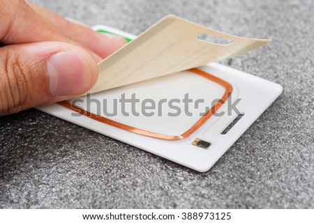 closeup circuit and antenna inside RFID card
