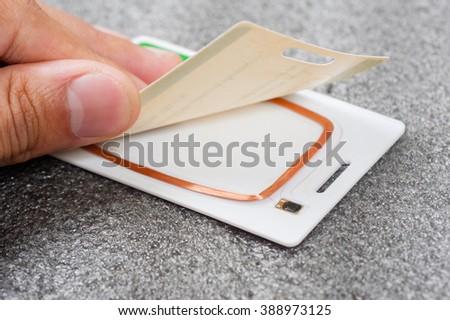 closeup circuit and antenna inside RFID card - stock photo