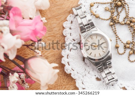 closeup classic woman wristwatch with stainless steel bracelet