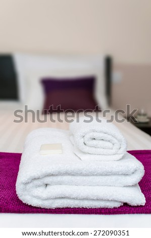 Closeup clean towels and soap in hotel room - stock photo