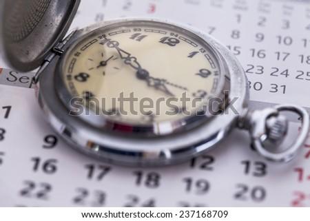 Closeup clock and calendar - stock photo