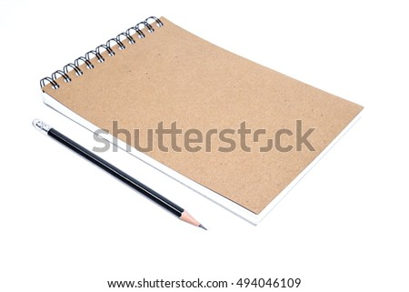 closeup close note book with pencil on background