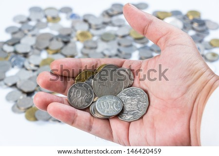 Closeup coins in hand for financial or investment concept - stock photo