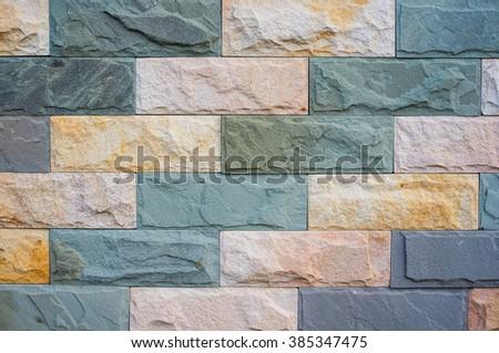 Closeup colorful bricks wall pattern, Stone wall decorative modern style - stock photo