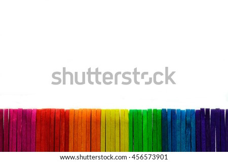 Closeup colorful popsicle sticks on white background.