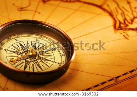 Closeup compass on white background