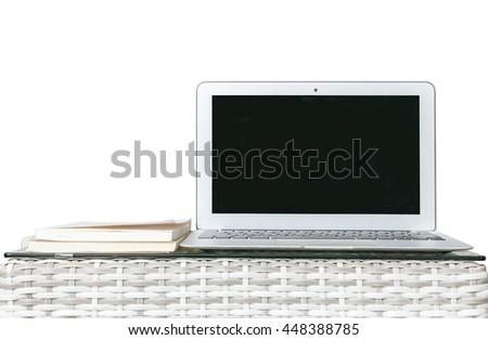 Closeup computer on blurred wood weave table and book isolated on white background , beautiful work place interior of house concept - stock photo