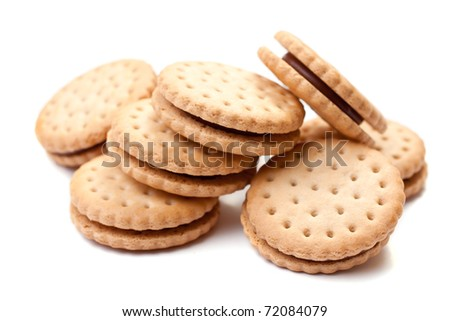 Closeup cookie biscuits with filling on white background