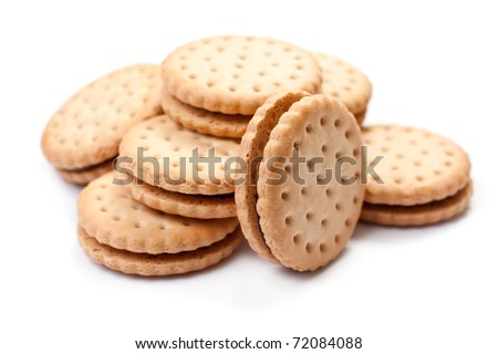 Closeup cookie biscuits with filling on white background - stock photo