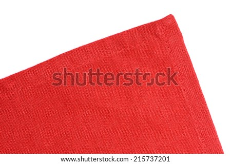 closeup corner of red napkin over white background - stock photo
