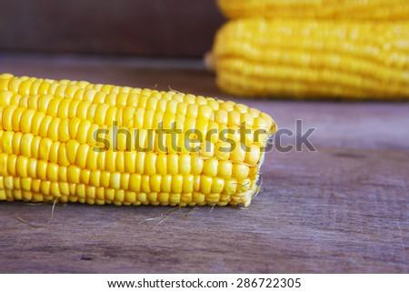 Closeup Corns on Wooden Table. - stock photo