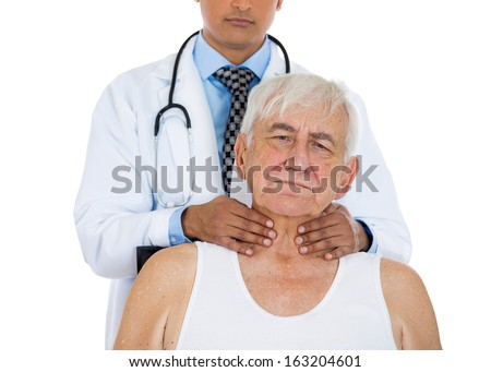 Closeup cropped image of a doctor performing physical exam, palpation of the thyroid gland. Young male doctor and elderly sick patient, isolated on a white background. Patient visit and care concept - stock photo