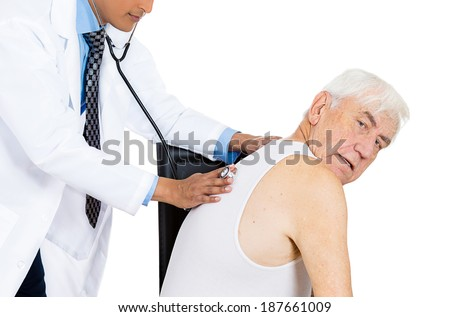 Closeup cropped portrait, doctor performing heart, lungs, chest, physical exam, listening with stethoscope on back of elderly senior mature man sitting on black chair, isolated white background. - stock photo