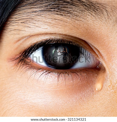 Closeup crying little asian girl looking her fighting parents in her eyes - stock photo