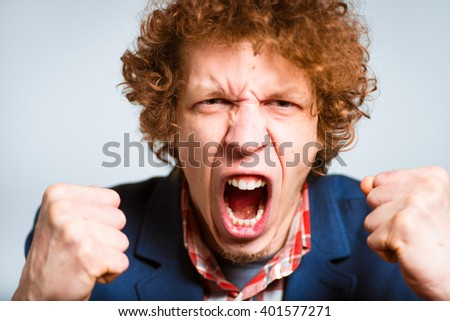 closeup curly man in anger isolated on a background