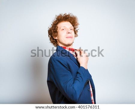 closeup curly man shows pride, isolated on background