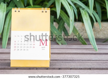 Closeup cute calendar in march on blurred garden view background - stock photo