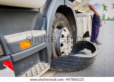 closeup damaged 18 wheeler semi truck burst tires by highway street in Thailand - stock photo