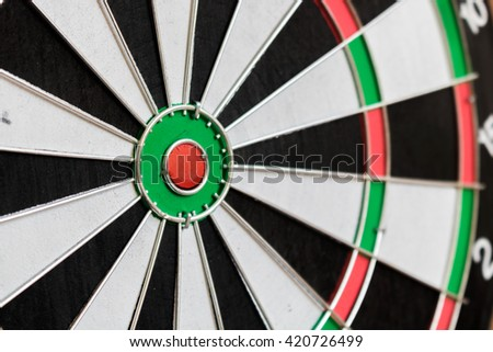 Closeup dartboard in the red center with selective focus.target aim goal concept background.
