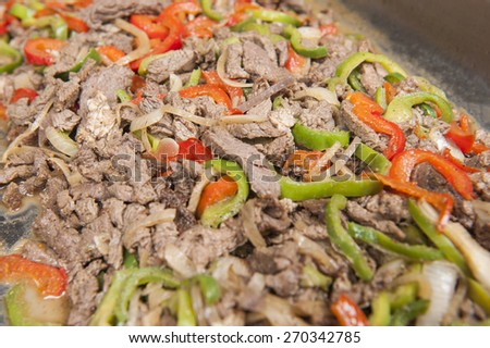 Closeup detail of a beef shawarma dish on display at an oriental restaurant buffet