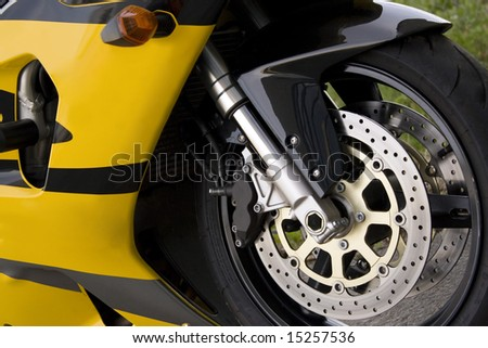 Closeup detail of a modern performance motorcycle. - stock photo